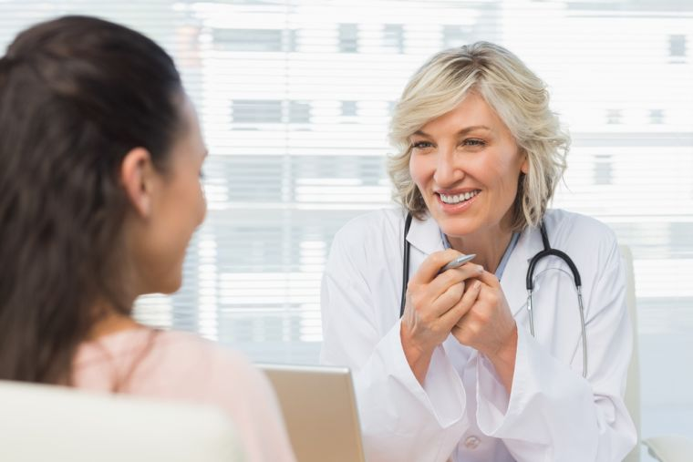 Latest research found that female doctors are better at empathy than male doctors. (Photo of a female doctor with a patient).