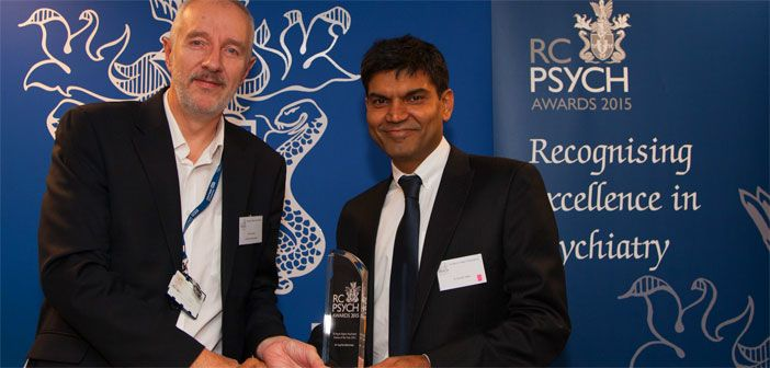 Dr Phil Davison collecting the Higher Psychiatric Trainee of the Year award on behalf of Dr Sophie Behrman