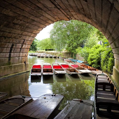 Group of punting boats seen under a bridge