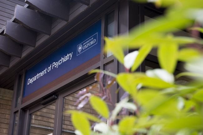 Image shows the front double doors of the Department of Psychiatry building.