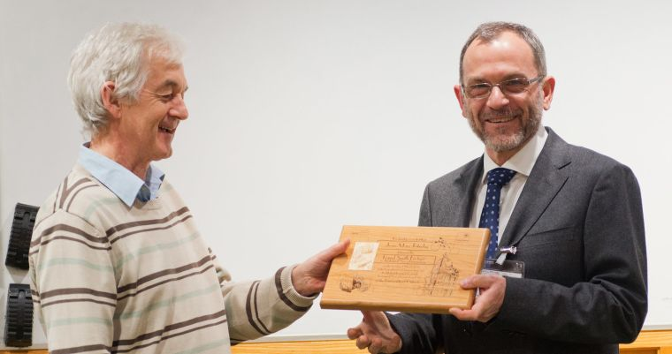 Peter Somogyi presents a commemorative plaque