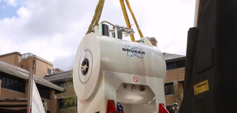 The new small-animal scanner for the Wellcome Centre for Integrative Neuroimaging is lifted into place at the Biomedical Services Building