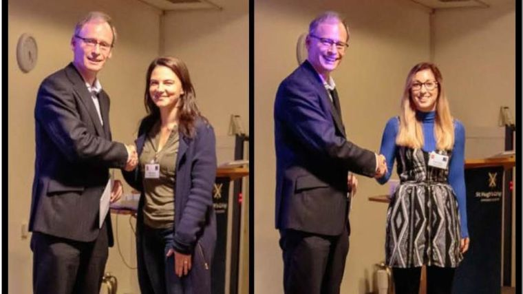 Filipa Simoes and Tonia Thomas receive their poster prizes and shake hands with prize presenter. Credit: Bob Mahoney