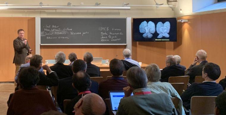 Zoltan giving talk academia europaea barcelona