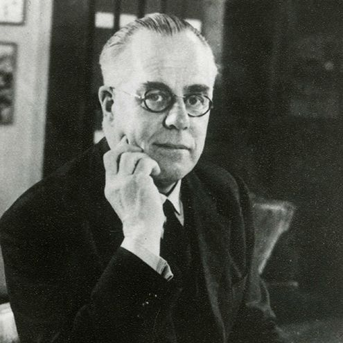 Black and white photograph of Wilfred Le Gros Clark at his desk.