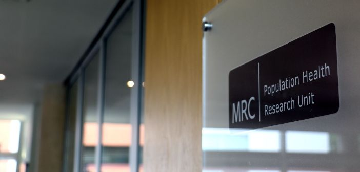 A wall sign showing 'MRC Population Health Research Unit'