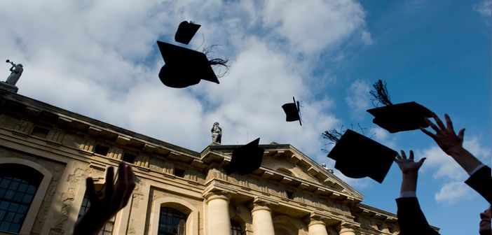 Mortar boards being thrown in the air.