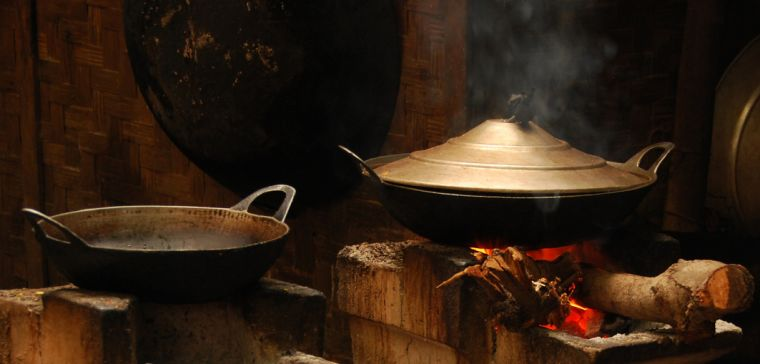 Pots cooking on open fires burning solid fuel.