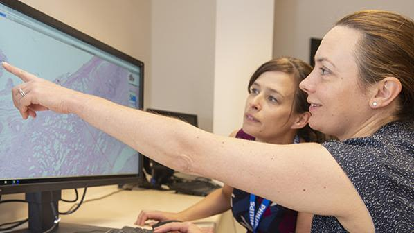 Dr Lisa Browning and Professor Clare Verrill, Honorary Consultant in Cellular Pathology at Oxford University Hospitals working with Philips IntelliSite Pathology Solution's Image Management System.