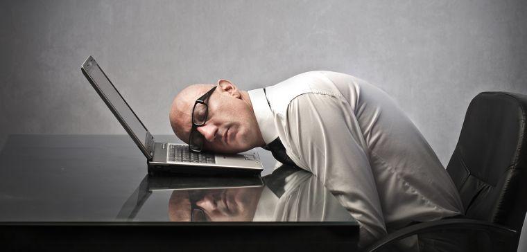 Man asleep on laptop