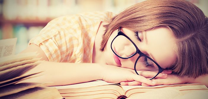 Girl asleep on books