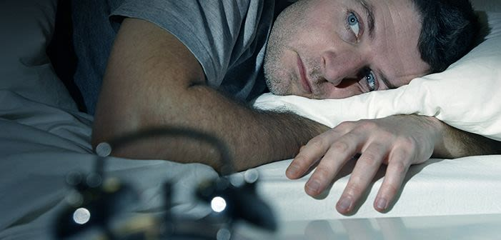 Man trying to get to sleep