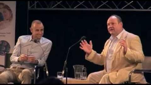 Evan Davis and Russell Foster on a platform talking