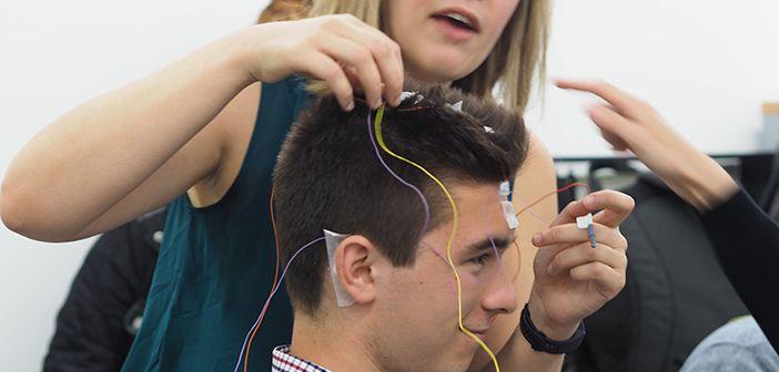 Young man having EEG