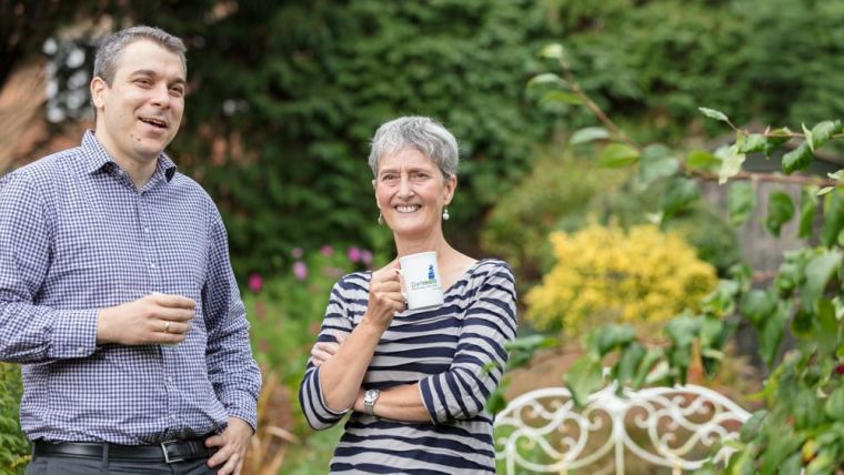 Marianne Talbot and Ivan Koychev stand in a garden smiling.