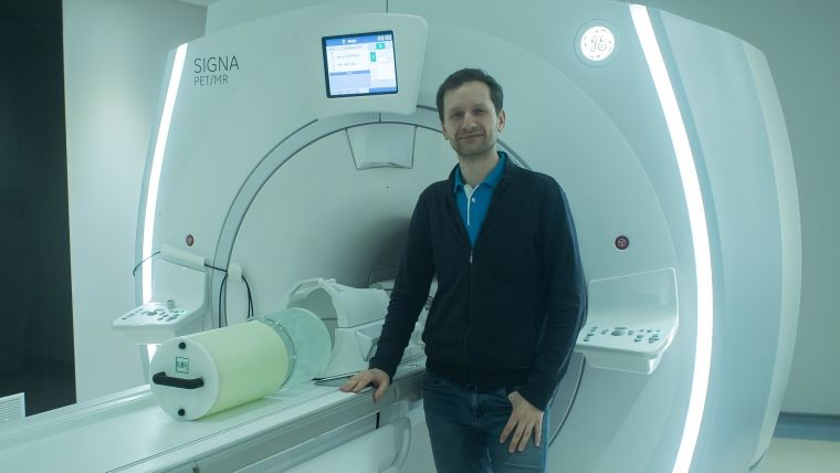 Pawel with a 'phantom' next to a scanner in the DPUK imaging network