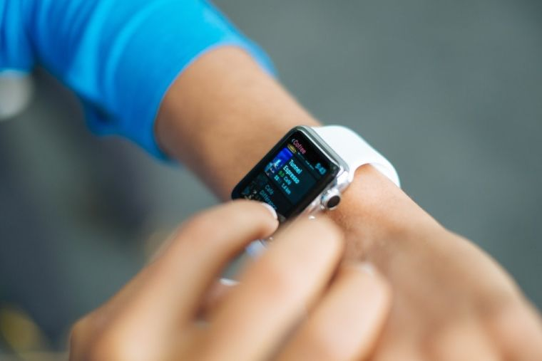 A person using a smart watch.