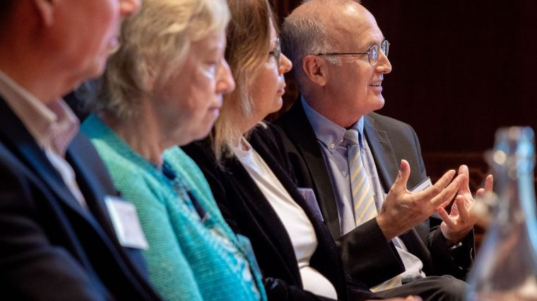 Four people sat on a panel including Professor John Gallacher.