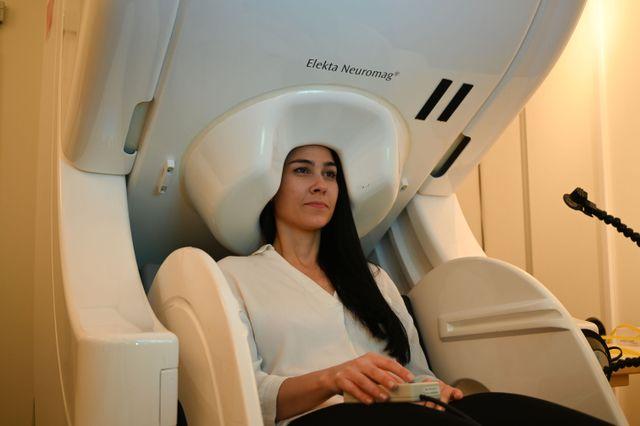 A woman undergoing a MEG brain scan