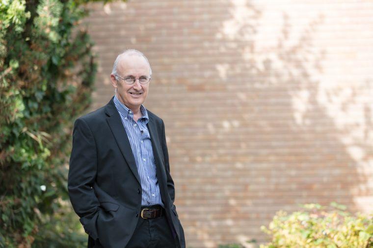 Professor John Gallacher standing outdoors