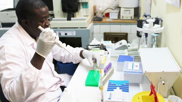 African malaria researcher working in the laboratory