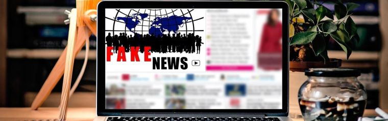 A computer screen reading 'Fake news'