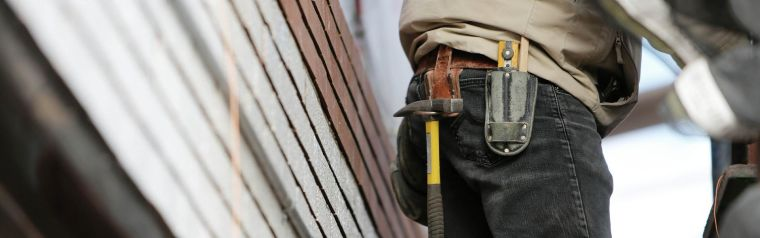 Close-up of a builder with tools attached to their belt