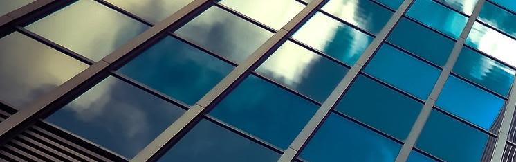 Glass windows in an office block reflecting the sky