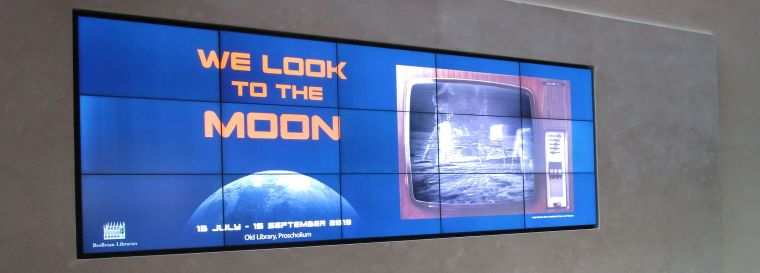 Banner from 'We look to the moon'