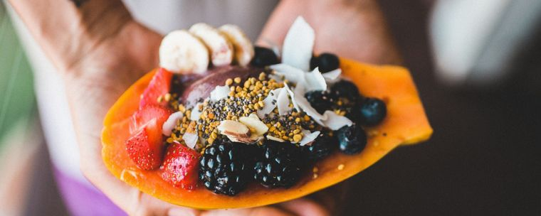 A plate of fruits and nuts