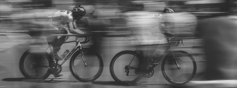 Two racing cyclist travelling at speed