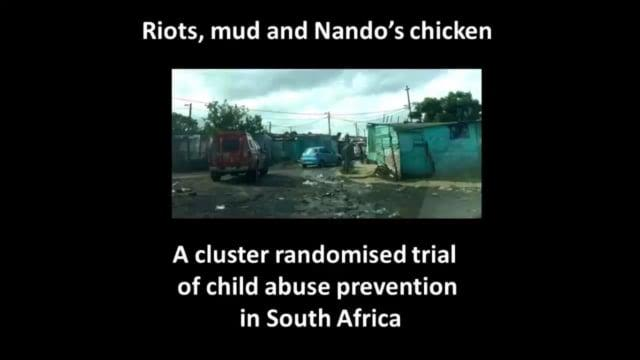 Lucy Cluver: Riots, mud and Nando's chicken. A cluster randomised trial of child abuse prevention in South Africa, with picture of a street in South Africa.