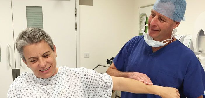 Head of Department Professor Andrew Carr assesses a patient with shoulder pain