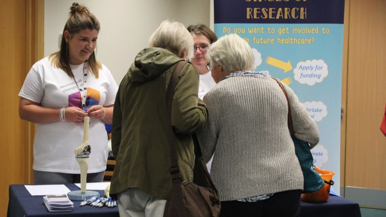 Picture of researchers talking to visitors