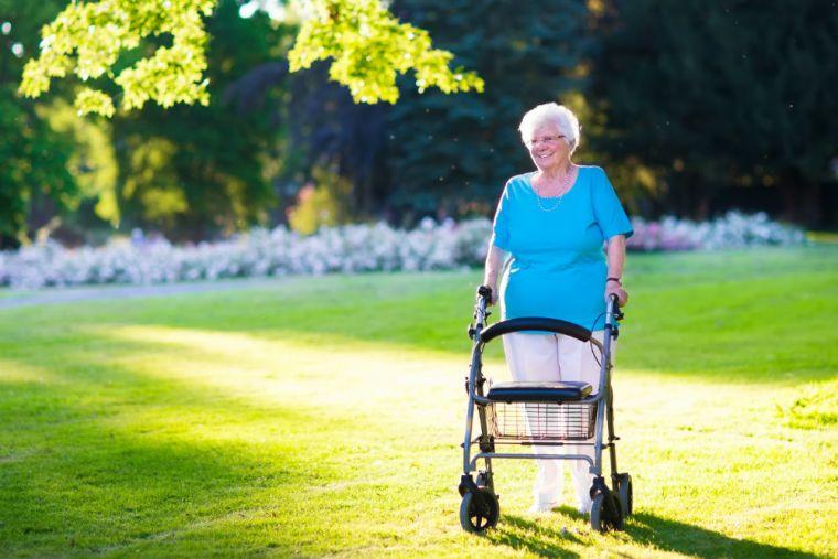 older woman uses walker outside