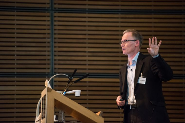 Picture of a lecturer gesturing.