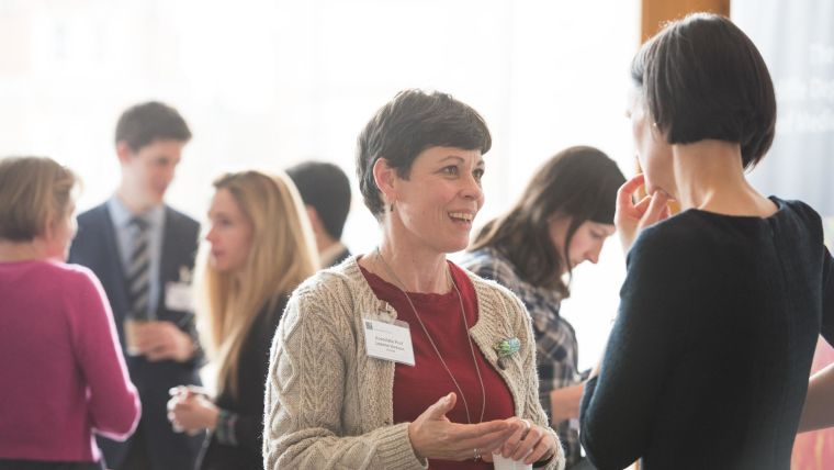 Picture of two female scientists talking.