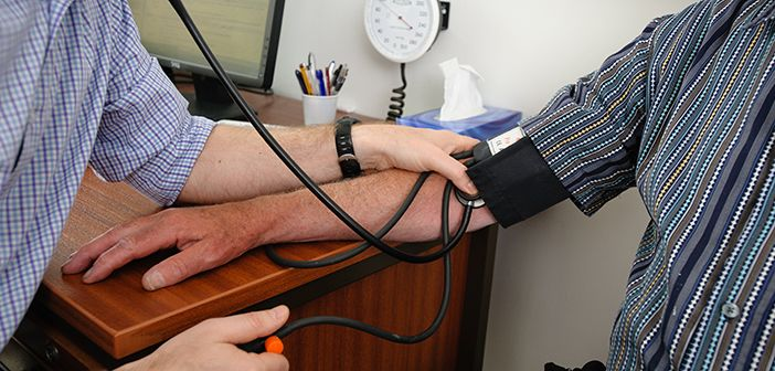 Patient having blood pressure taken