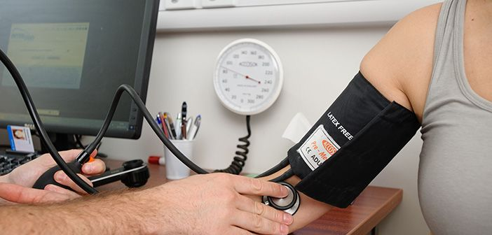 Photo of woman having her blood pressure taken