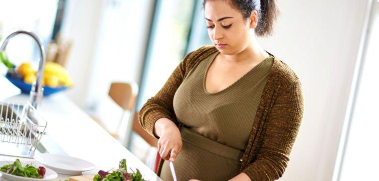 Overweight woman preparing healthy food