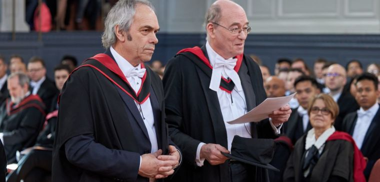 John Harris (left) receives his honorary MA at the Sheldonian Theatre.