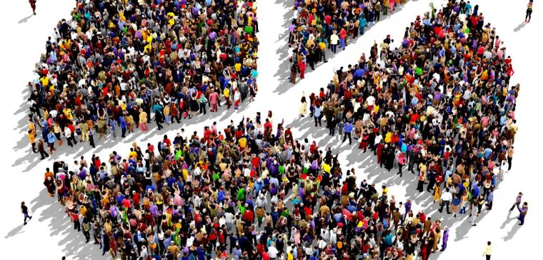 Large group of people seen from above gathered together in the shape of a pie chart