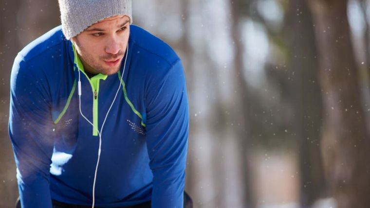 a breathless male runner taking a break