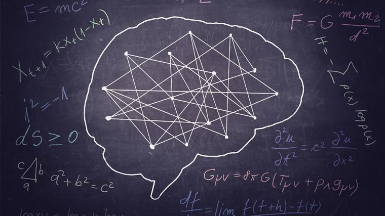 Blackboard drawing of a brain and science formulas