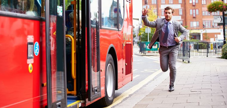 A man running to catch a bus