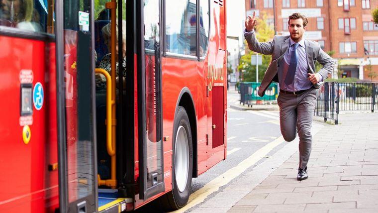 A man running to catch a bus