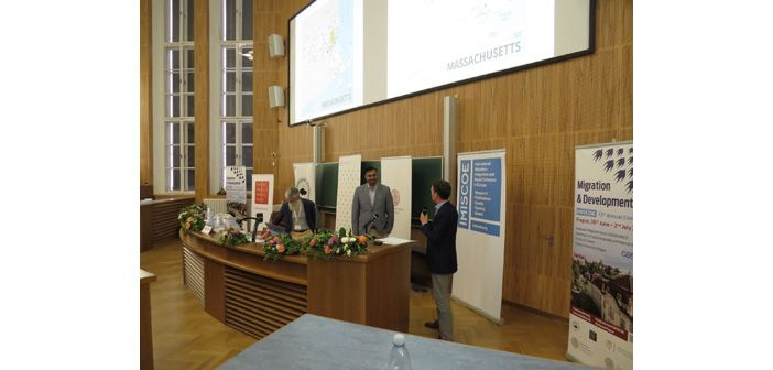 Ali receiving imiscoe best paper award