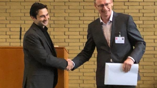 Poster prize success for sam bose in the burton lab