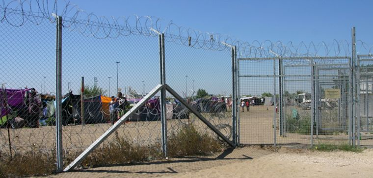 View of Röszke makeshift refugee camp from the Hungarian side of the Serbia-Hungary border