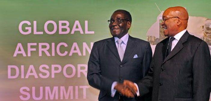President Jacob Zuma welcomes President Robert Mugabe of Zimbabwe at the Global African Diaspora Summit, Johannesburg, South Africa